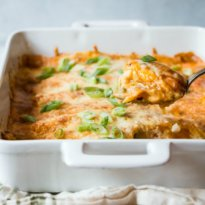 The best Sour Cream Chicken Enchiladas are stuffed a delicious creamy filling, topped with buttery enchilada sauce, and baked with lots of cheese!