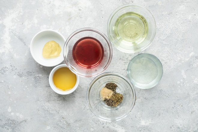 The best Italian dressing ingredients in various bowls.