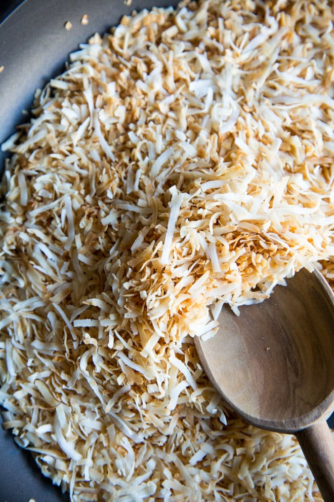 Learn how to toast coconut two different ways: In the oven and on the stove in a skillet. Works for shredded or shaved coconut, sweetened or unsweetened!