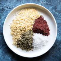 This easy Za'atar Recipe is a Middle Eastern spice blend made with just 4 ingredients. Try it on meats, vegetables, homemade bread, dips, soups, or salads.