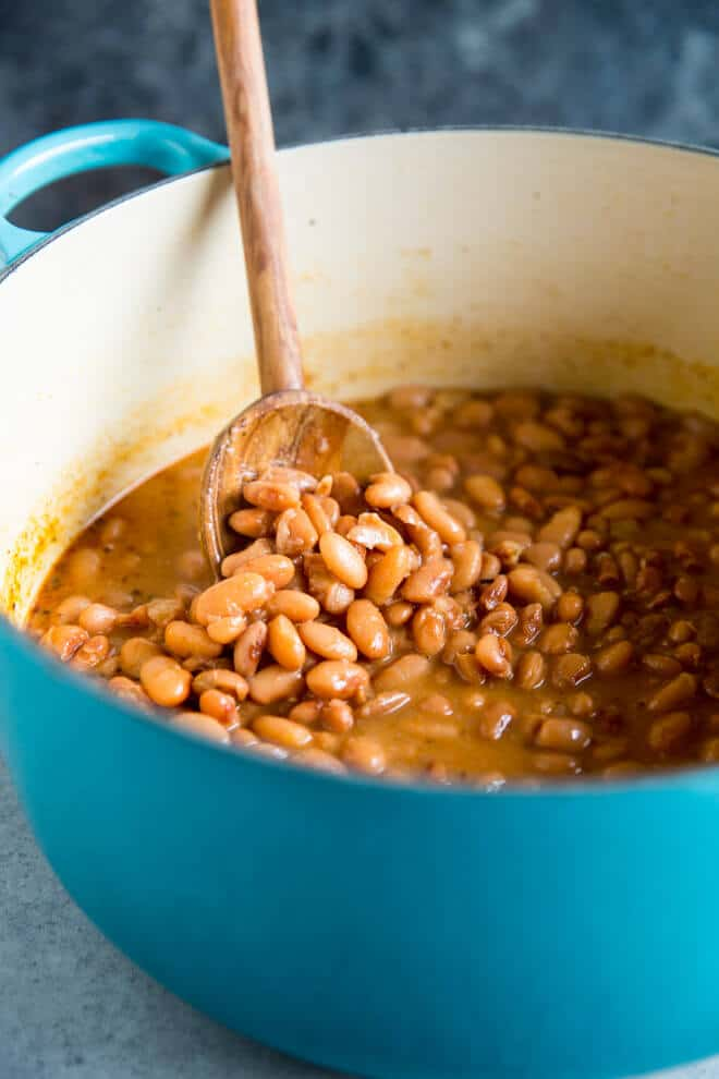 These copycat Chipotle Pinto Beans are easy to make, inexpensive, and healthy! Add to burritos and salads or serve with rice for a tasty vegetarian meal.