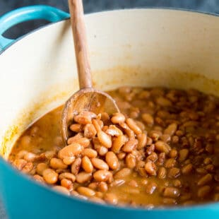 A side shot of chipotle pinto beans in a pot.