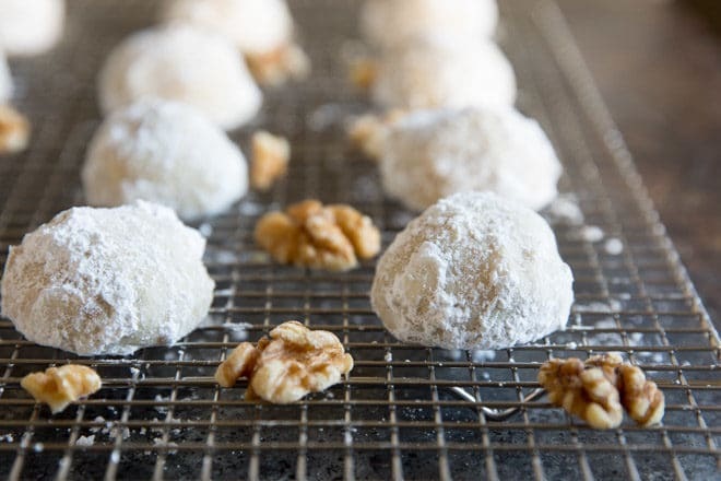 These easy Mexican Wedding Cookies have walnuts in the dough and are rolled in powdered sugar so they look exactly like snowballs! Perfect for Christmas.