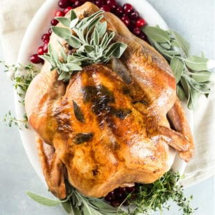 The perfect Roast Turkey is dry brined for maximum flavor and moisture, then basted in both butter and olive oil. Plus an easy recipe for delicious gravy!