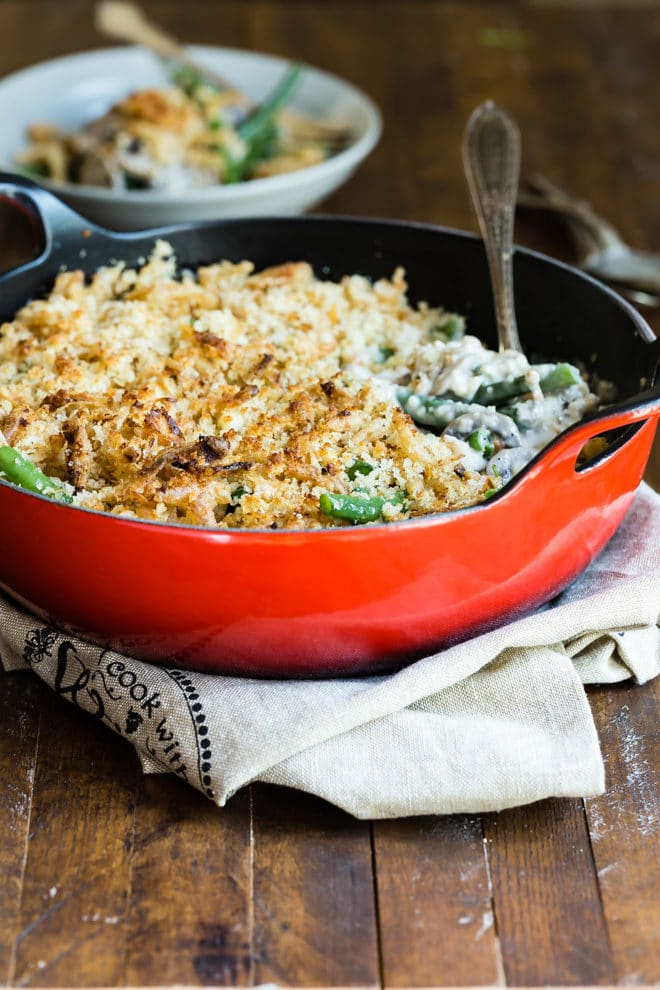 Green bean casserole in a red skillet.