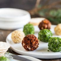 Perfectly portioned and flavored with three different toppings, these mini cheese balls are easy, delicious, and perfect for the holidays!