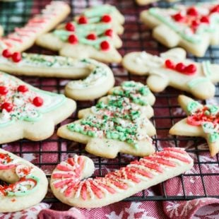Christmas sugar cookies on a cooling rack.
