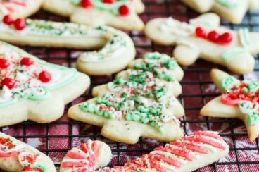 Christmas sugar cookies on a cooling rack.