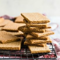An easy recipe for Homemade Graham Crackers. Made with 100% whole wheat flour and molasses, these are so much better than store-bought crackers!