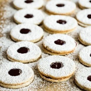 Linzer cookies on parchment paper.