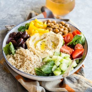 Mediterranean buddah bowl in a white bowl.