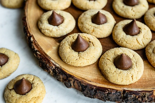 An easy Peanut Butter Blossoms cookie recipe. Soft, chewy peanut butter cookies are rolled in sugar, baked, and topped with a single Hershey's kiss!