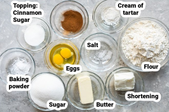 Ingredients for Snickerdoodles in bowls and labeled.