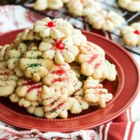 Spritz cookies on a red plate.