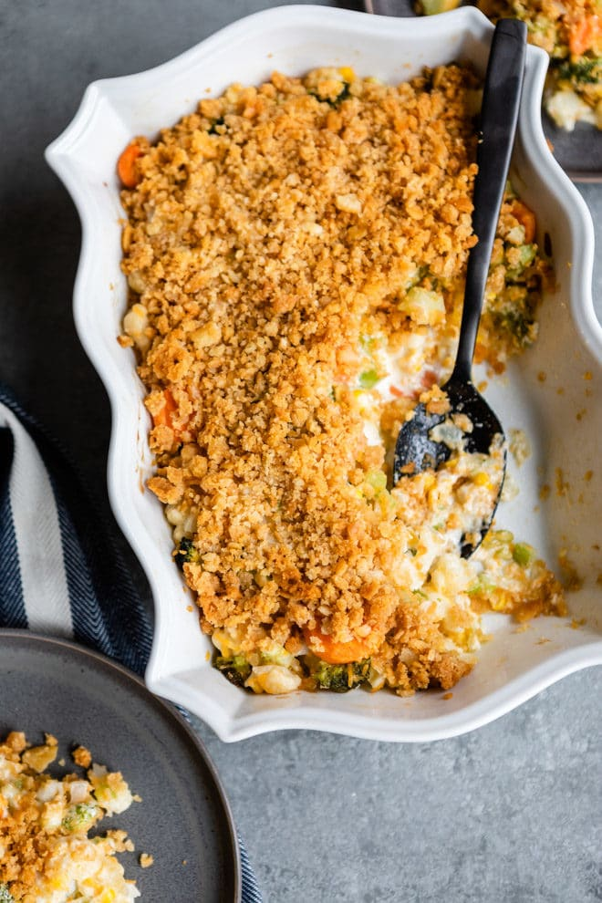 If you're looking for a vegetable side dish to feed a crowd, you've hit the jackpot with this Vegetable Casserole! Combine frozen vegetables with common pantry items for a quick and easy make-ahead masterpiece. Fresh vegetables can be used in replace of the frozen, or try my tips to make it healthier!