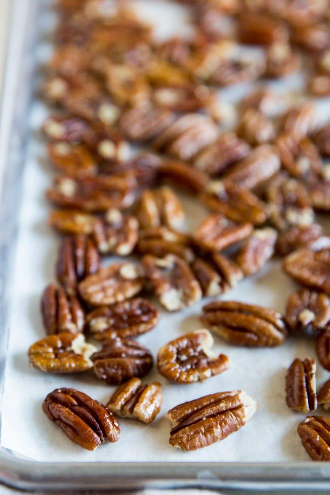 Pecans on a baking sheet.