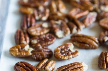 Pecans on a baking sheet.