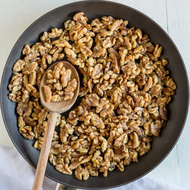 An easy recipe for how to toast walnuts in the oven or on the stove. Enhance the flavor of walnuts, then add to salads, snack mixes, baked goods, and more!