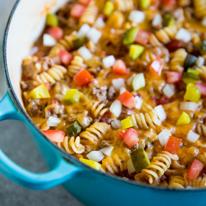 This easy One Pot Cheeseburger Casserole is the ultimate comfort food! Best of all, it comes together in one pot, on the stove top, in 30 minutes or less.