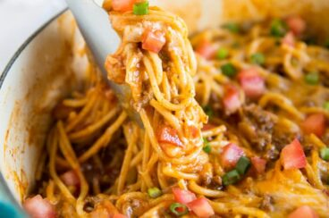 Taco Spaghetti is fast, easy, and comes together in 30 minutes or less - all in one pot. The juice from the tomatoes and the added liquid cooks the spaghetti to perfection and creates its own taco-seasoned sauce. Tasty, satisfying, and delicious, you can even make baked spaghetti pie with the leftovers. That is, if you have any!