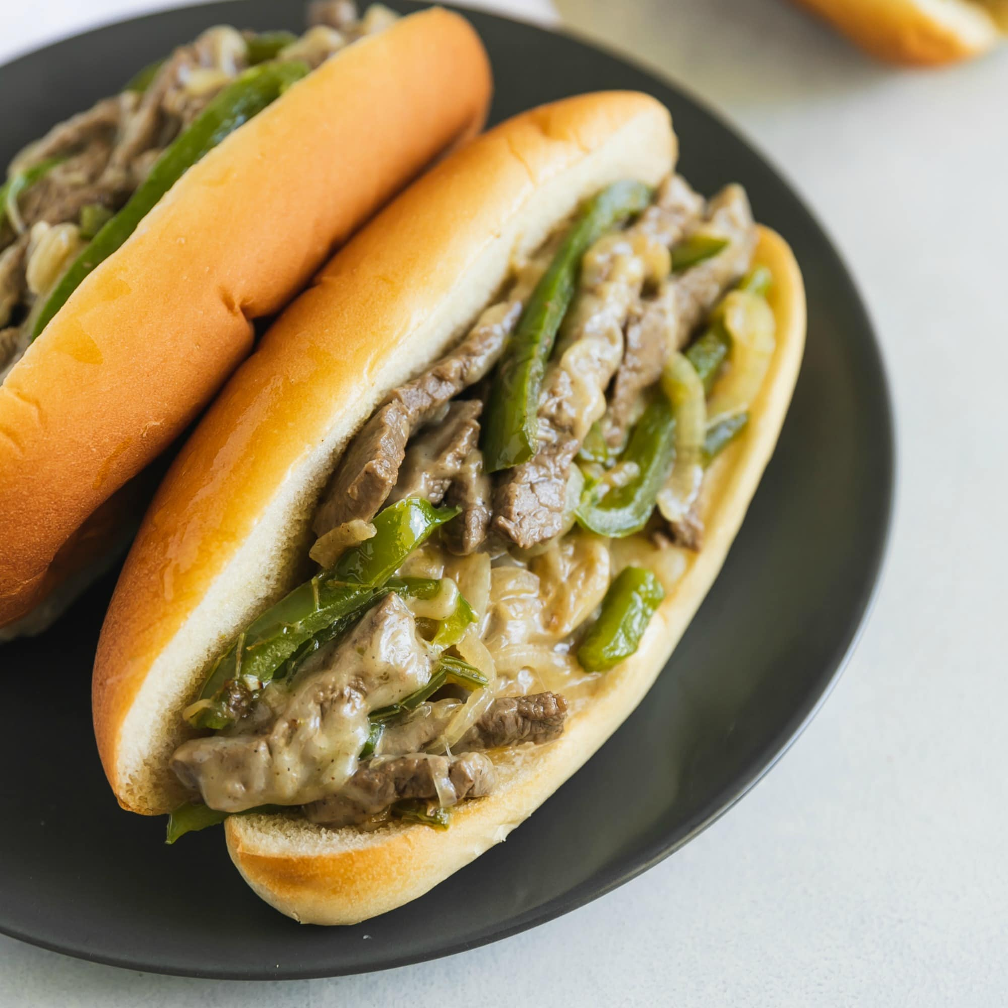 Ever heard of a sandwich so popular, that it's become an ingredient all by itself? That's right: the Philly Cheese Steak can also be pizza topping, a potato chip, and even a soup. But let's explore the real deal, the famous sandwich that is loved (and debated) far and wide by everyone who bites into it. Tender thin beef, onions, and gobs of gooey provolone on a bun that soaks up every last bit of flavor. Nothing could be better than this recipe, in or outside of Philadelphia.