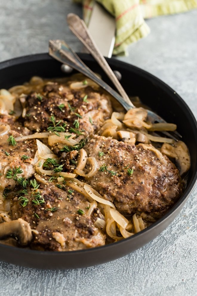 An easy Salisbury Steak recipe! Juicy patties seared for flavor and smothered in a mushroom and onion sauce to finish cooking. Classic comfort food. Your whole family is going to love this recipe!