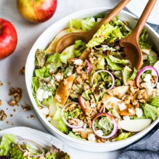Whether you need a fresh lunch idea, a new favorite summer salad, or a tasty way to eat foods that make you feel great, this easy Apple Walnut Salad checks all the boxes. It's a perfect combination of crisp lettuce, sweet apples, crunchy walnuts, salty feta cheese, and a lightly sweetened Balsamic Vinaigrette. It has all the colors, flavors, and textures you crave!