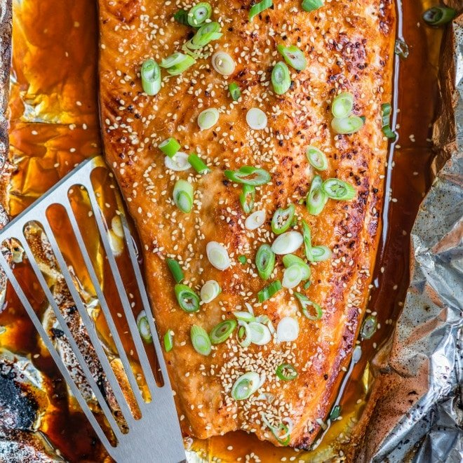 Sweet, salty, spicy, sticky, ​umami​. This Asian Salmon in foil is a fool-proof recipe to get dinner on the table fast with the least amount of effort! Wrapping the salmon in foil seals in all the flavor and ensures a tender, flaky texture, while the last two minutes of broiling gives your salmon an irresistible glaze. All you have to do is toss the foil at the end .. no cleanup required.