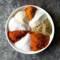 Skip the store-bought packets and make your own homemade Fajita Seasoning! It's incredibly simple and can be mixed together in minutes (and you can reduce or omit the salt and the sugar if you want to). This versatile spice blend is great on fajitas, tacos, burritos, quesadillas, and more! The best part: It lasts for ages, so go ahead and make a double batch.