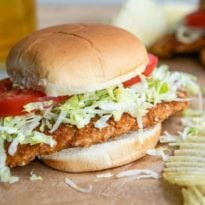 A classic sandwich in the Midwest, this pork tenderloin sandwich is crispy, crunchy, and quite similar to the famous Weiner Schnitzel.  Breaded in a cracker crust and pan-fried, all that's left to do is sandwich it between a soft hamburger bun, slather with a bit of mayo, and top with lettuce and tomato.  The pork version is a riff on the German schnitzel, Schweineschnitzel.  Try saying that five times fast!