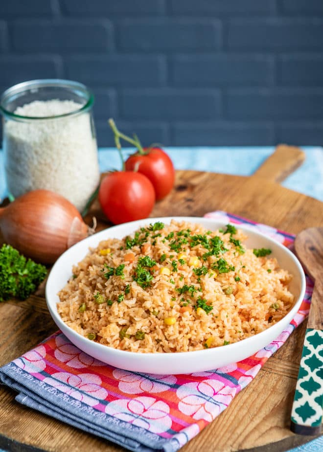 Tomatoes, onions, garlic, oh my!  This authentic recipe for Spanish Rice is sure to impress as it is quick, simple, flavorful, and technique-driven to ensure the perfect texture every time!  All your missing is a side of beans and a margarita to go with it.