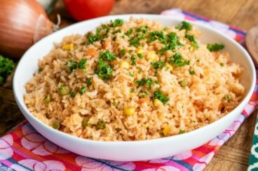 Spanish rice in a white serving bowl.