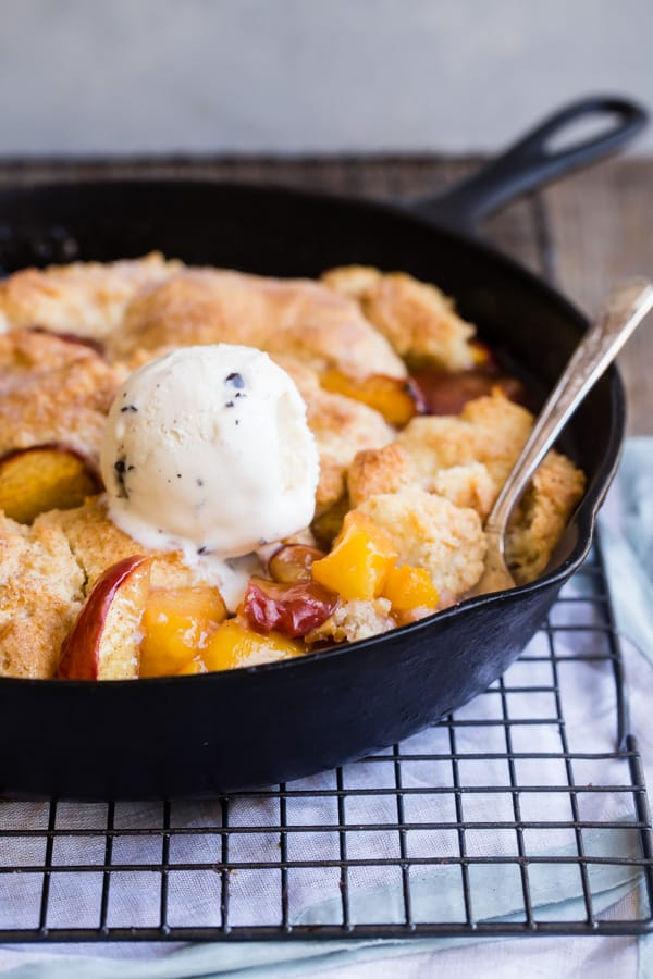 Not too sweet and perfectly spiced, there's no better summer dessert than a warm peach cobbler, fresh out of the oven, with a scoop of vanilla bean ice cream. No need to grab a box of cake mix, because this made-from-scratch recipe comes together in a flash and bakes up into fluffy, golden brown perfection. This summer, life's a peach!