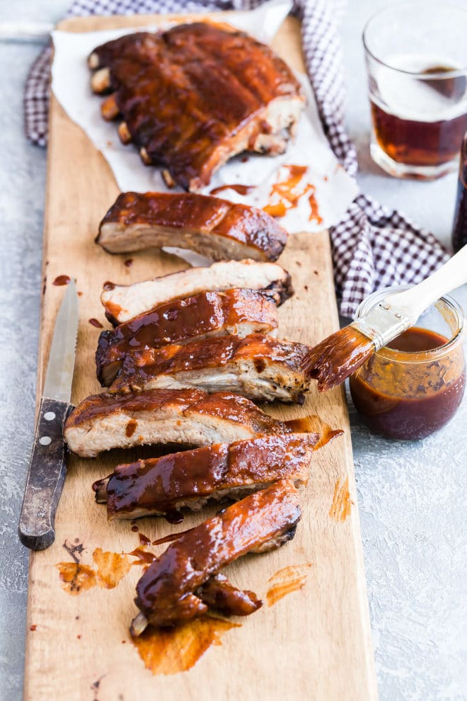 You don't need a smokehouse and a gazillion hours to make your own award-winningly tender, fall-off-the-bone, melt-in-your-mouth barbecue ribs. This recipe is what I make when I want the best, most phenomenal ribs at home. It frees me up to concentrate on planning the party and figuring out the side dishes, too.