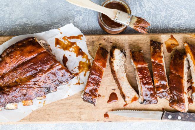 Barbecue ribs on a cutting board.