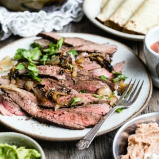 It's summer grilling season; if you follow your nose in Southern California, chances are you'll find delicious Carne Asada on the coals at every backyard party. Once it's marinated, this irresistible recipe cooks up faster than it takes to finish your first margarita. Make more than you think you need, because everyone loves carne asada with all the fixings.