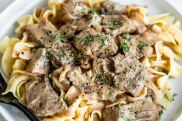 Easy beef stroganoff on a white plate.