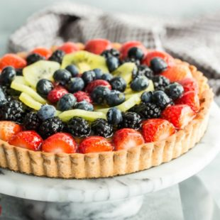 Loaded with a lush assortment of seasonal berries and other fruit, this fruit tart recipe is just the sort of elegant, deceptively simple dessert to serve at the end of a special lunch or dinner. Because of its glossy apricot glaze, which is a little pastry trick I'll show you, folks will always ask if it's from a fancy French pâtisserie. Whether you say oui or non is entirely up to you.