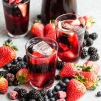 In the summer when fresh berries are bursting at the seams, there's no better beverage than this recipe for iced tea berry sangria. Stunning as a signature cocktail for a romantic summer wedding, but just as wonderful as a pitcher shared with some close friends in the backyard. Hopefully, if you love iced tea as much as I do, you'll be sipping this little berry beauty on the regular!