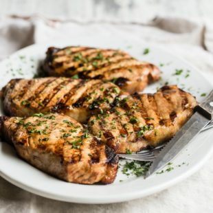 Grilled Pork Chops on a white platter.