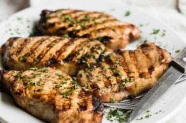 Grilled Pork Chops on a white platter.