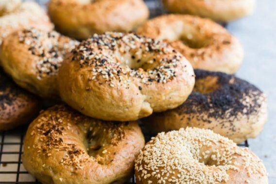 Homemade bagels on a cooling rack.