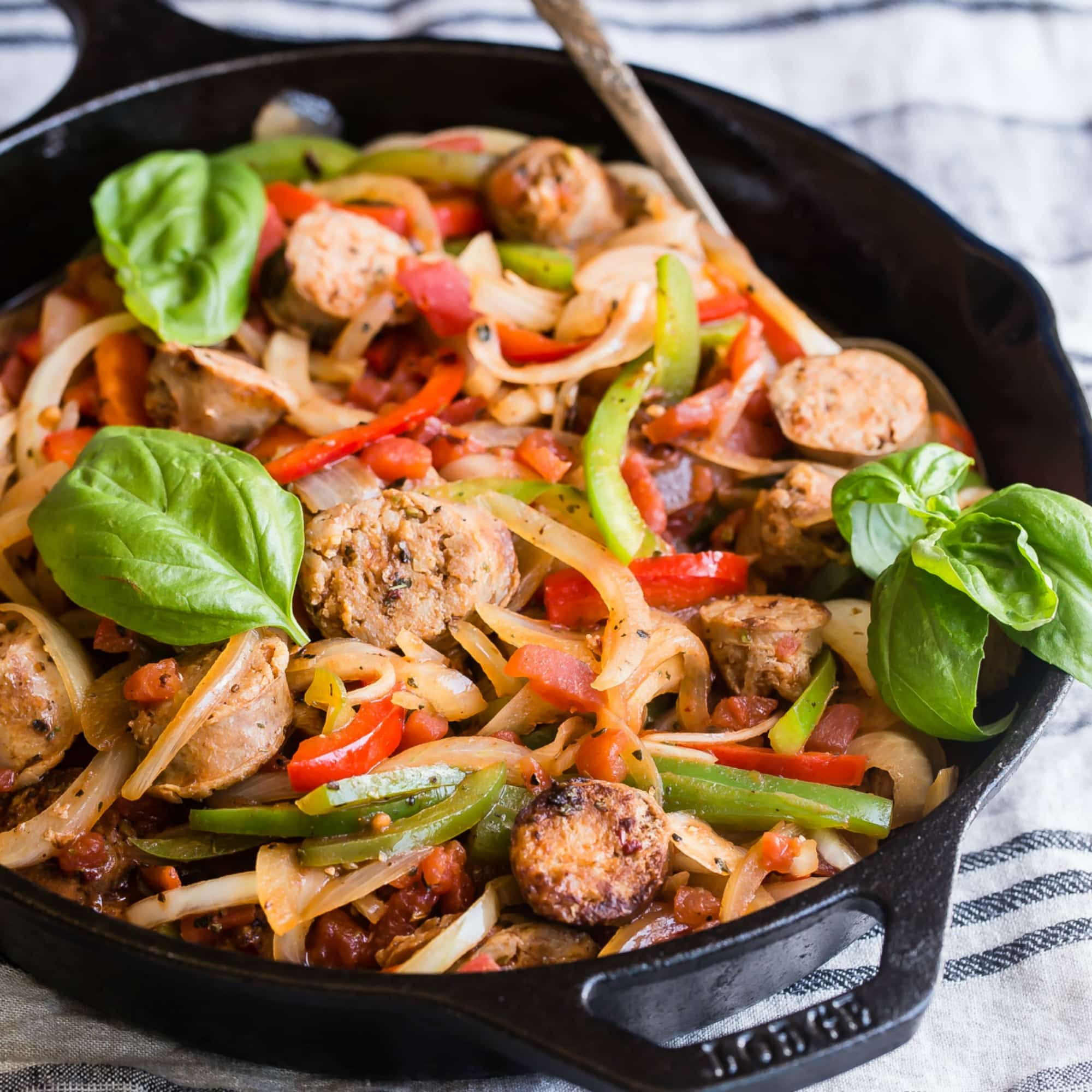 Italian sausage and peppers—it doesn't get any more iconic than this sweet and spicy dish bursting with summer vegetables and juicy Italian sausage. Perfect for big family get togethers or potlucks; slice up some crusty bread and everyone can dish up their own, just the way they like it.