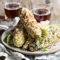 I'm betting that this Mexican street corn, known as elote, will be your new favorite way to eat  corn on the cob this summer, even if you're a purist in the corn department. The cobs are fire roasted until lightly charred, and then covered with a spicy mixture of sour cream, mayonnaise, cilantro, and chile powder, which melts into the hot kernels and tastes absolutely fantàstico!