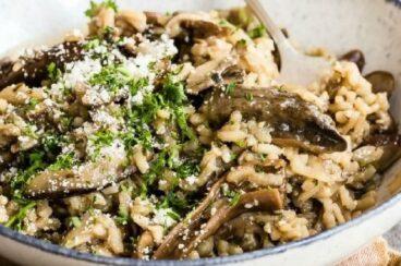 Mushroom risotto in a white bowl.
