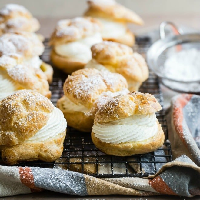 If you're looking for the irresistible cream puffs that have been served at the Wisconsin State Fair since 1924, you've come to the right place. These light-as-air pastries are filled with a lightly sweetened whipped cream and topped with a dusting of powdered sugar. Everyone has their own special way of eating them, but absolutely no one can resist the power of a cream puff.