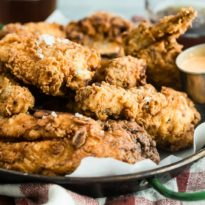 Fried chicken can be so easy to buy these days, but it doesn't hold a candle to honest to goodness, mouthwatering, homemade fried chicken. If you've never made it yourself, then it might be time to scratch it off your bucket list and get frying. This classic recipe is the real deal with a golden, crunchy buttermilk batter that tastes great hot or cold.