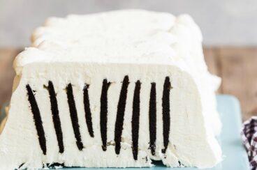 Icebox cake on a blue platter.
