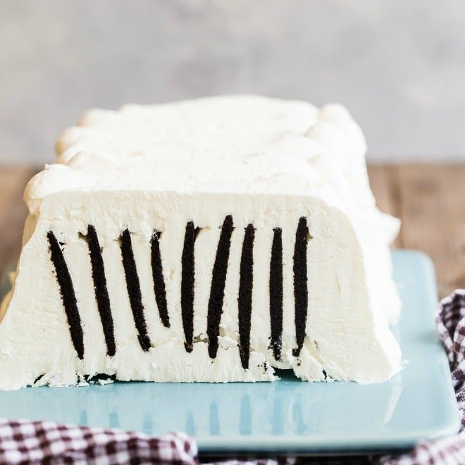 For anyone who has tasted it, this old fashioned, no-bake icebox cake just might be the closest thing to a culinary miracle you can get. Even if you didn't grow up eating this incredible dessert, now is your chance to make sweet memories of your own. All you need is some whipped cream, the thinnest, crispiest cookie ever, and about ten minutes.