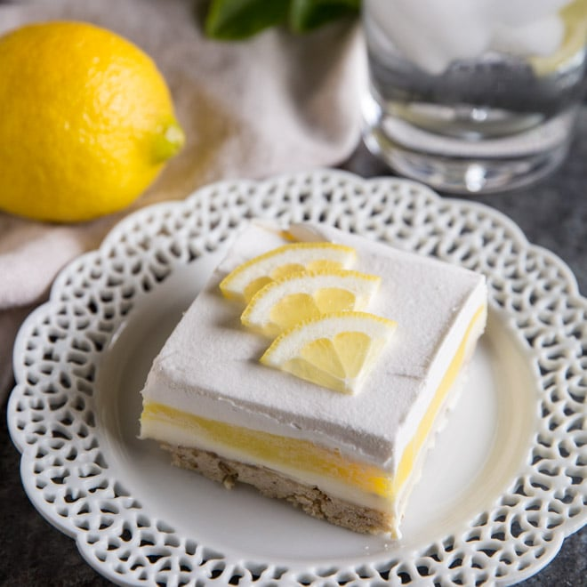 Lemon Lush is an easy dessert recipe made with layers of pecan shortbread, sweetened cream cheese, lemon pudding, and whipped topping. Rediscover this classic summer dessert or enjoy it for the first time. You'll want to go light on dinner so you have plenty of room left for Lemon Lush!
